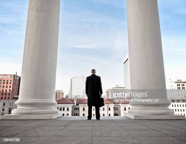 Caucasian businessman looking at cityscape