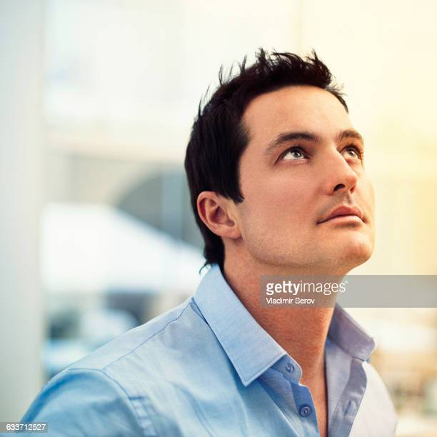 Caucasian businessman looking up