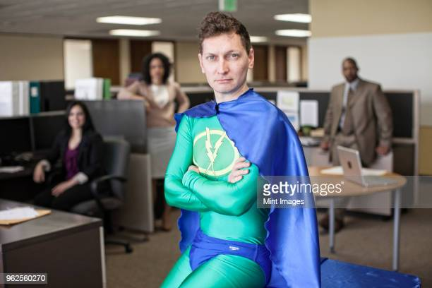a caucasian businessman office super hero and his office staff - superman stock pictures, royalty-free photos & images