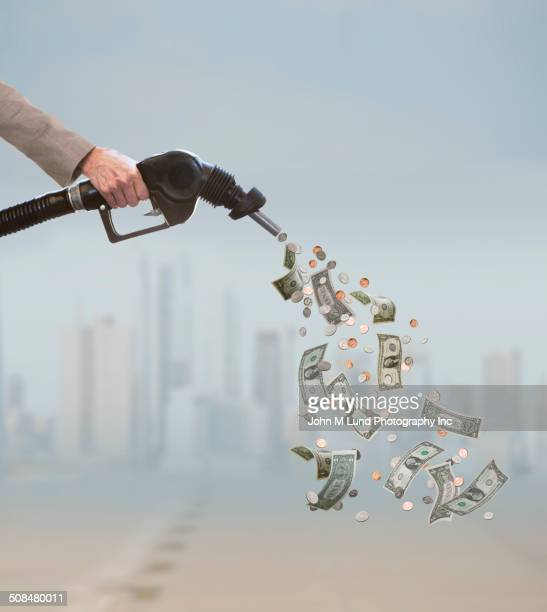 Caucasian businessman pumping expensive fuel