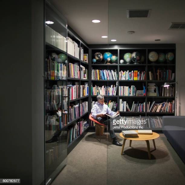 Caucasian businessman reading in library