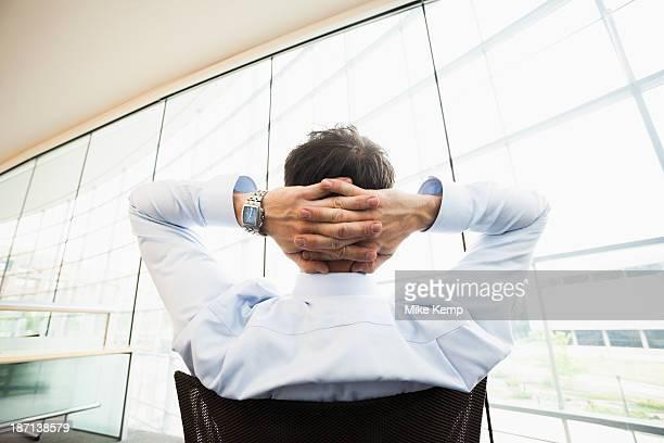 Caucasian businessman relaxing at desk