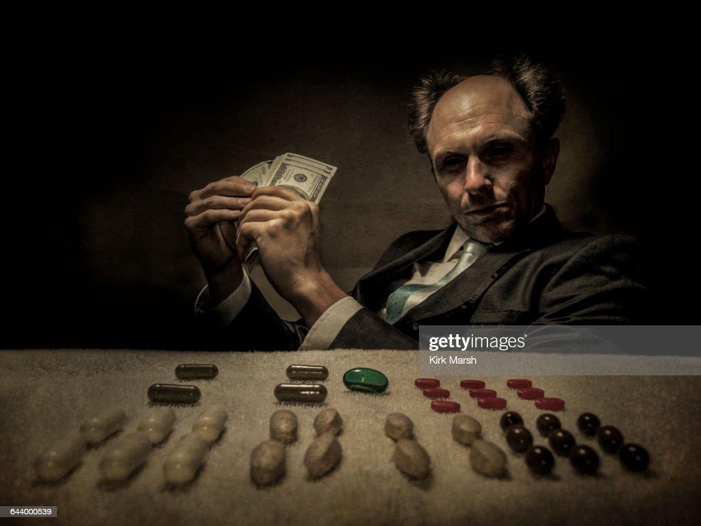 Caucasian businessman selling pills : Stock Photo