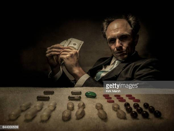 Caucasian businessman selling pills