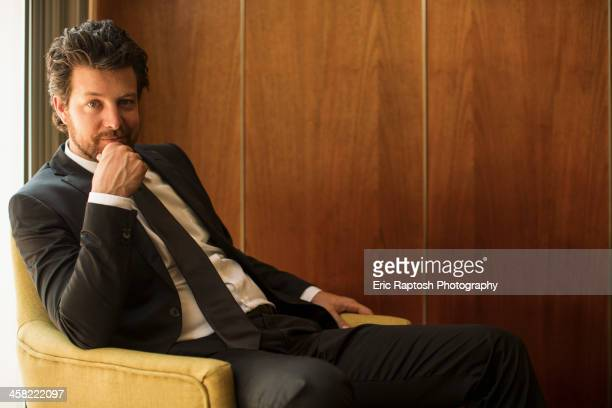 caucasian businessman sitting in armchair - formal stock pictures, royalty-free photos & images