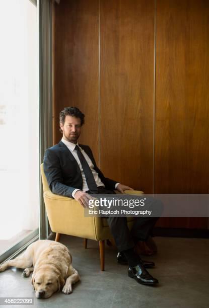 Caucasian businessman sitting in armchair