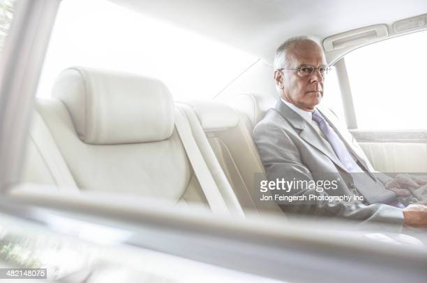 Caucasian businessman sitting in car