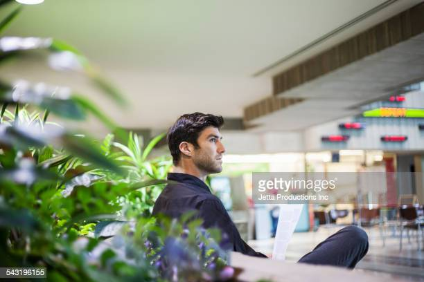 Caucasian businessman sitting in lobby area