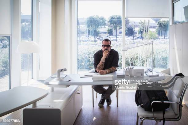 Caucasian businessman sitting in modern office