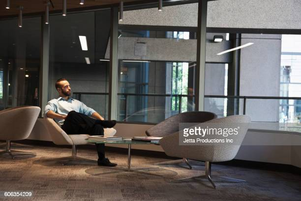 Caucasian businessman sitting in office lounge