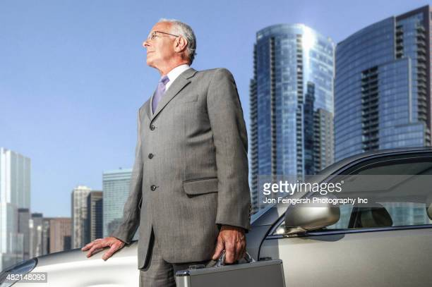 Caucasian businessman standing by city skyline