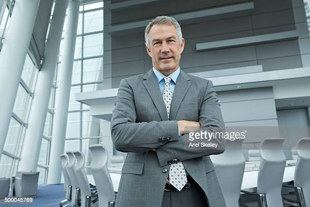 Caucasian businessman standing in conference room