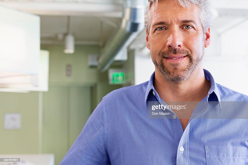 Caucasian businessman standing in office : Foto stock