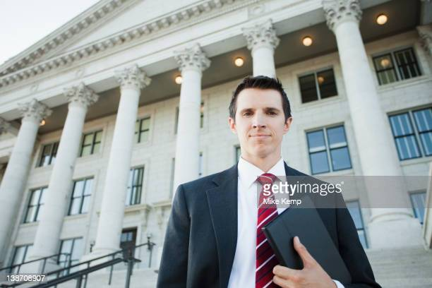 Caucasian businessman standing outdoors