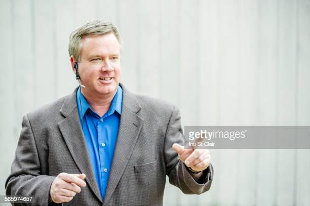 Caucasian businessman talking on headset