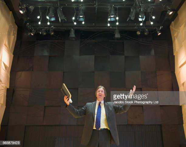 caucasian businessman talking on stage - pastor stock pictures, royalty-free photos & images