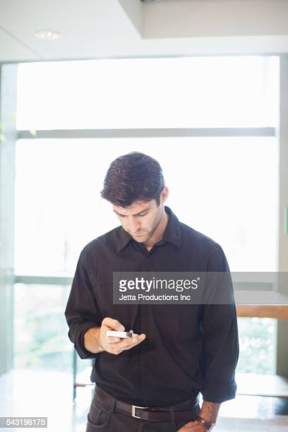 Caucasian businessman using cell phone
