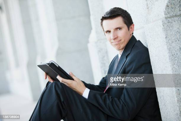 Caucasian businessman using digital tablet outdoors