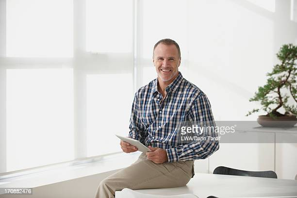 Caucasian businessman using tablet computer in office