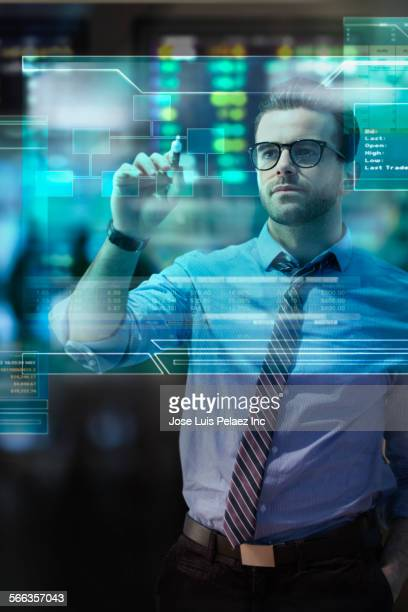 Caucasian businessman using touch screen in office