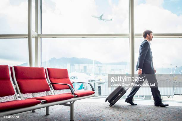 Caucasian businessman walking in airport