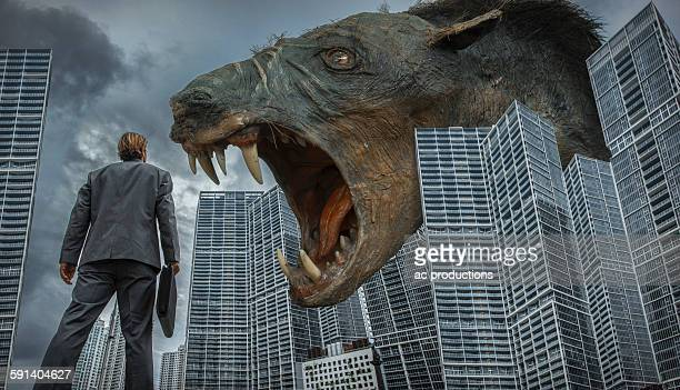 Caucasian businessman watching monster rat in city