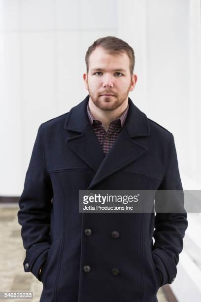 Caucasian businessman wearing wool coat