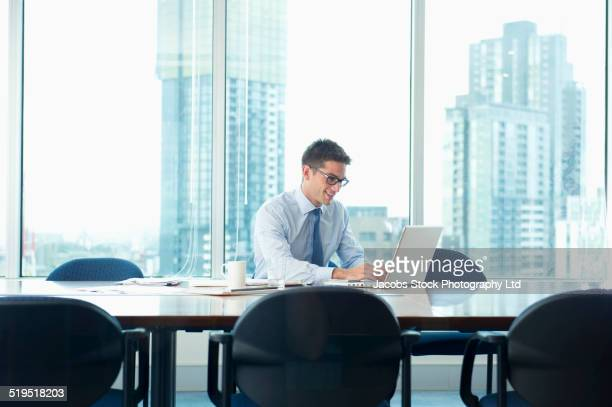 Caucasian businessman working at conference table