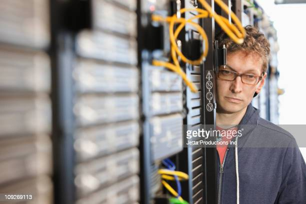 Caucasian businessman working in office technology room