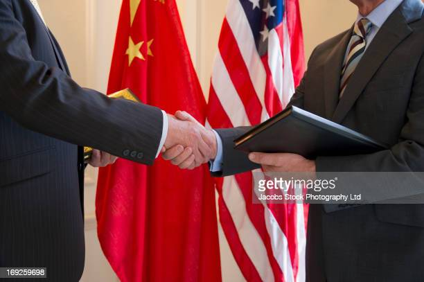 caucasian businessmen shaking hands - international politics stock pictures, royalty-free photos & images