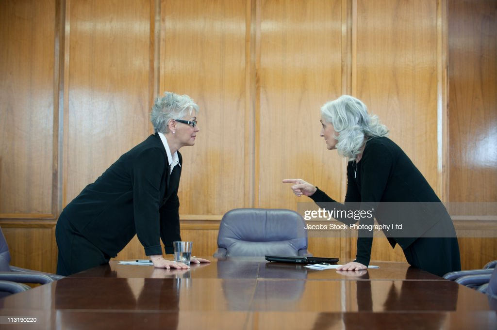 Caucasian businesswoman arguing in conference room : Stock Photo