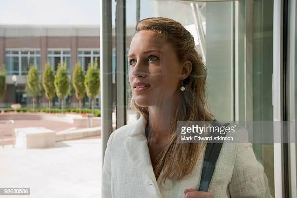 Caucasian businesswoman entering office building