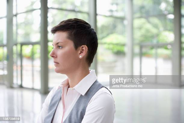 Caucasian businesswoman in lobby