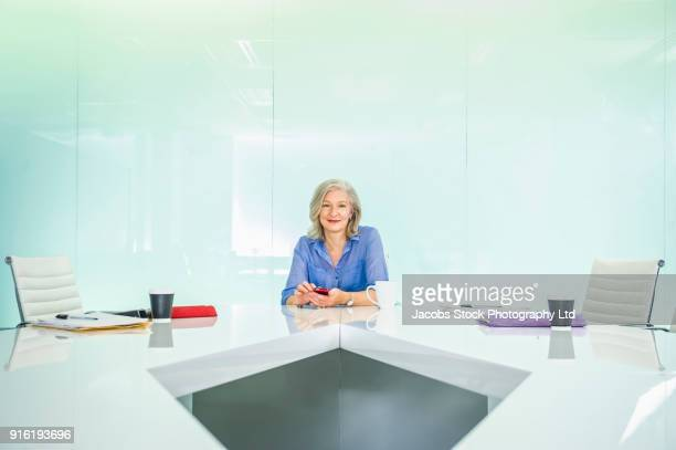 Caucasian businesswoman in modern conference room