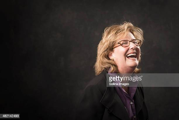 Caucasian businesswoman laughing