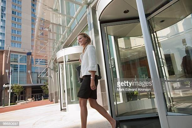 Caucasian businesswoman leaving office building