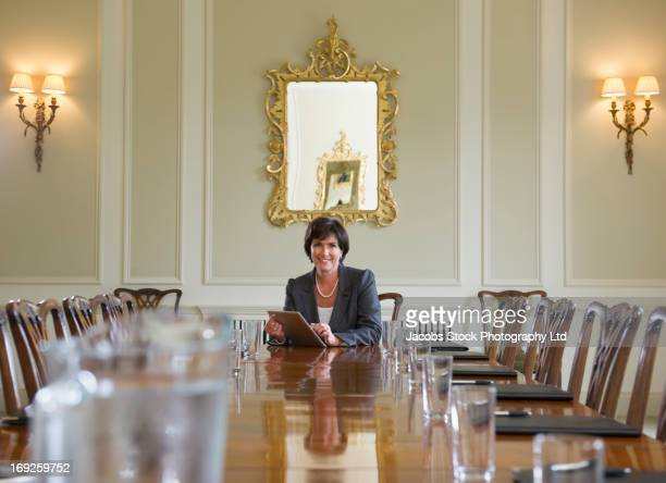 Caucasian businesswoman sitting at meeting table