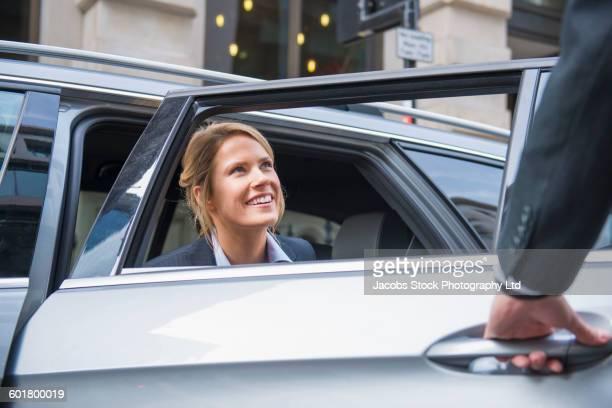 Caucasian businesswoman sitting in car