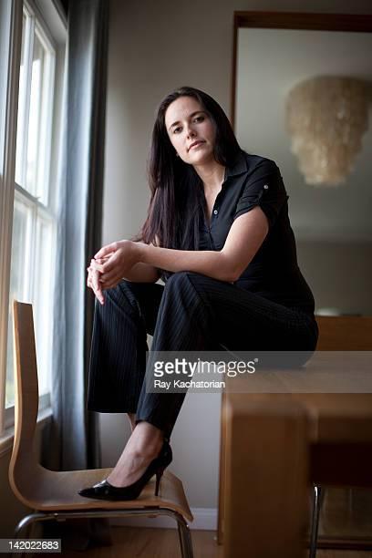 Caucasian businesswoman sitting in table