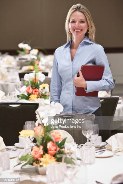 Caucasian businesswoman smiling in dining room