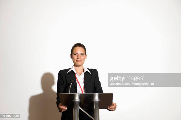 caucasian businesswoman speaking at podium - one young woman only stock pictures, royalty-free photos & images