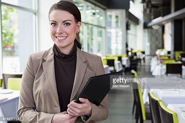 Caucasian businesswoman standing in restaurant