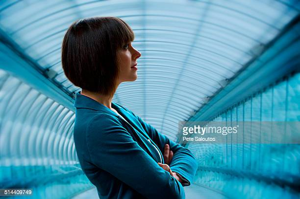 Caucasian businesswoman standing in tunnel