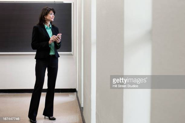 caucasian businesswoman using cell phone - tensed idaho stock photos and pictures