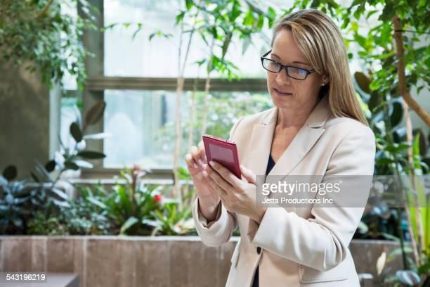 Caucasian businesswoman using cell phone