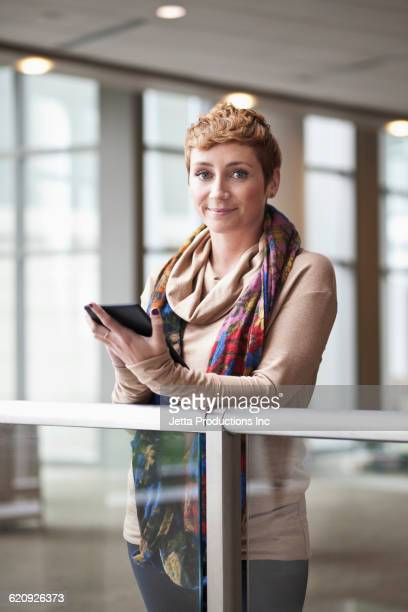 Caucasian businesswoman using digital tablet in office