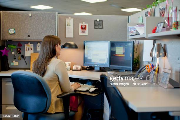 Caucasian businesswoman working at desk in office
