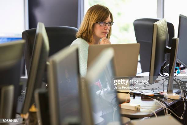 Caucasian businesswoman working in office