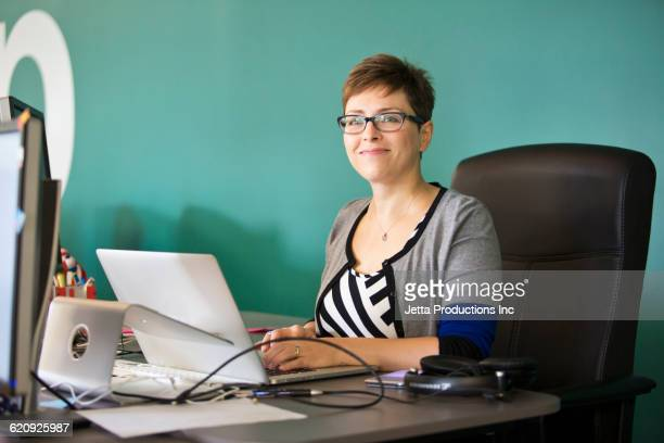 Caucasian businesswoman working in office