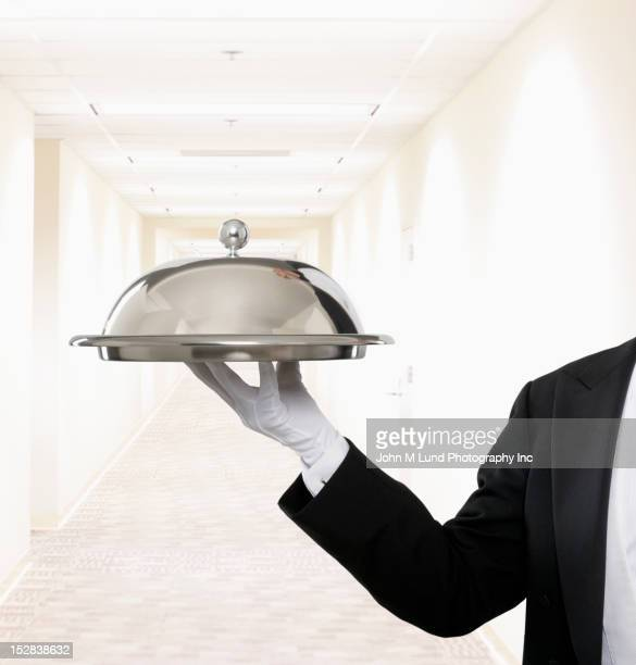 caucasian butler holding covered tray in hallway - white glove stock pictures, royalty-free photos & images